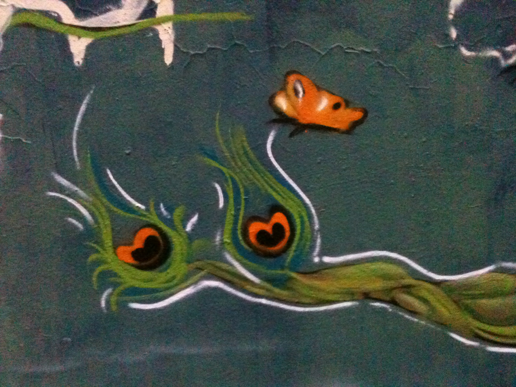 graffiti of a butterfly hovering a branch that contains two nests of hearts