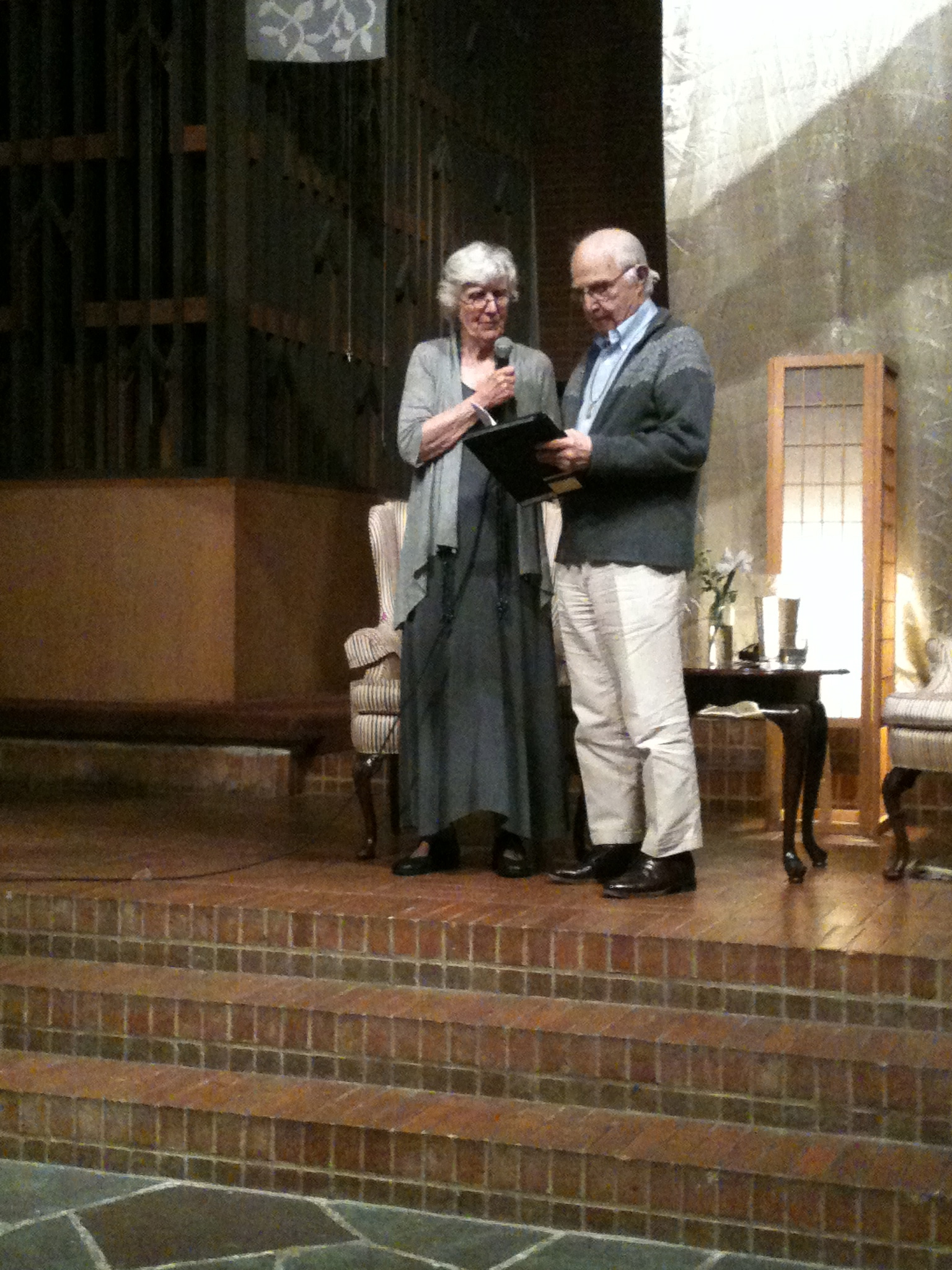 Pat and Peter Schneider, reading one of Peter's poems, just before the announcement of the creation of the Pat and Peter Schneider Fund, to be housed at Pacific School of Religion and to assist those wanting to be trained as certified AWA method facilitators!