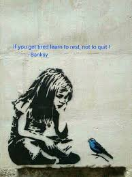 "Picture of little white girl sitting crosslegged, looking at a bluebird, beneath the words, ""If you get tired learn to rest, not to quit! -Banksy"""