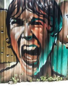 graffiti of woman screaming