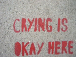 red graffiti of the words Crying Is Okay Here