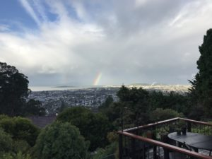 photo of clouds over El Cerrito, rainbow emerging from the bay