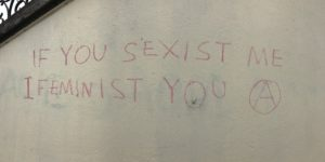 "spray painted graffiti: ""You sexist me, I feminist you"""