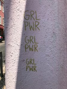 spray painted graffiti: GRL PWR GRL PWR GRL PWR