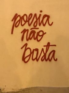 "red spray-painted graffiti, ""poesia não basta"""