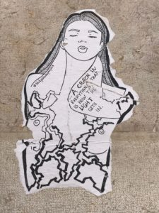 "sticker image, line drawing of a woman with cracks running through her torso -- overlaid are the words, ""There's a crack in everything, that is how the light gets in."""