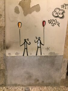 graffiti, two people holding balloons, talking to each other