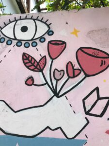 abstract graffiti, containing an eye and some red flowers