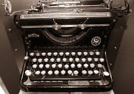 `photo of a black antique typewriter